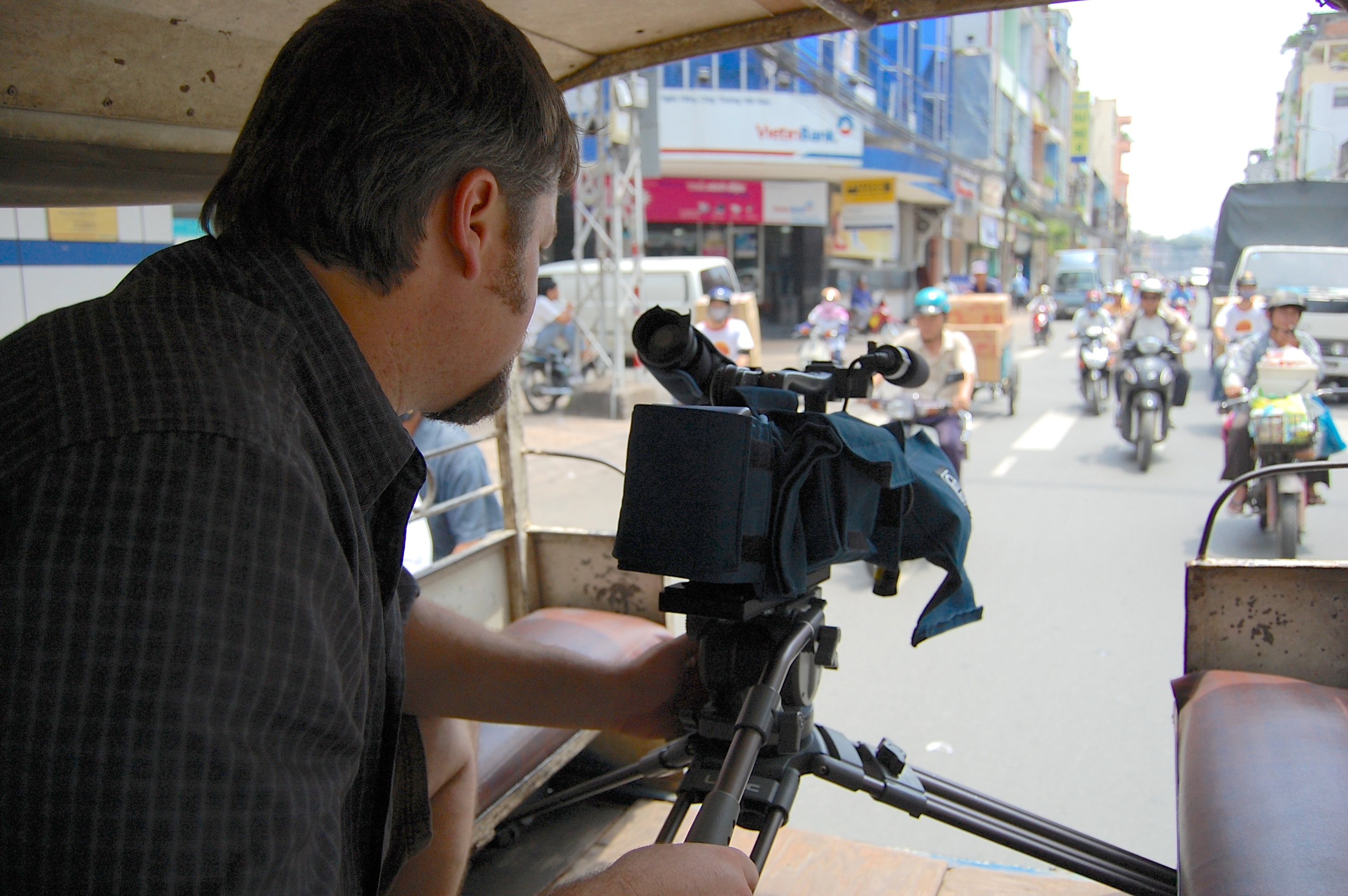 Jeff Butler Filming from the back of a motor cart taxi in Saigon, Vietnam