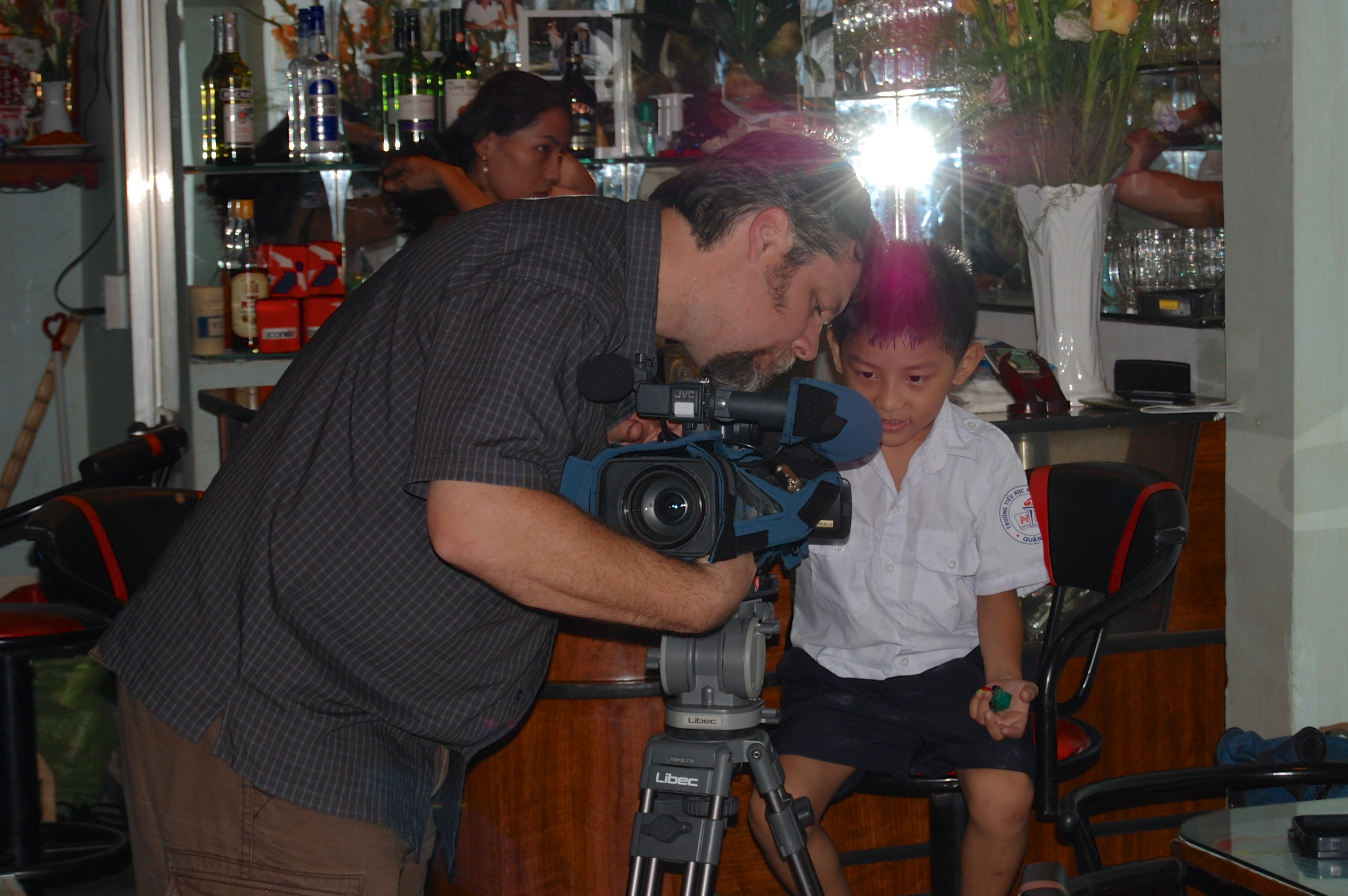 Jeff Butler showing a young filmmaker the ropes in Saigon, Vietnam
